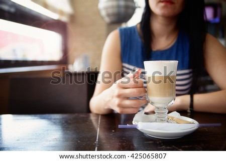 photo of the young woman drink coffee - stock photo