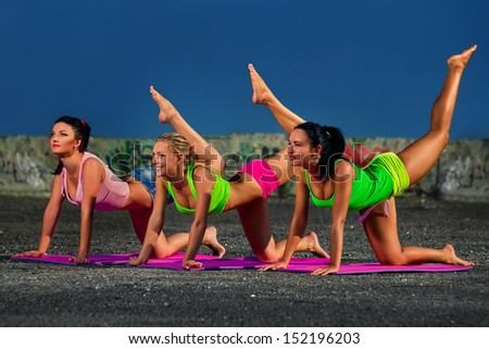 Photo of three girls stretching for warm up before exercise   - stock photo