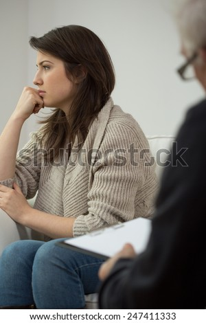 Photo of unhappy young woman on therapy - stock photo