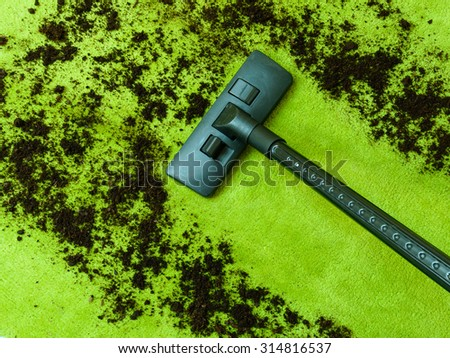 Photo Of Vacuum Cleaner Cleaning Dirt On Carpet. Spring Cleaning Concept - stock photo