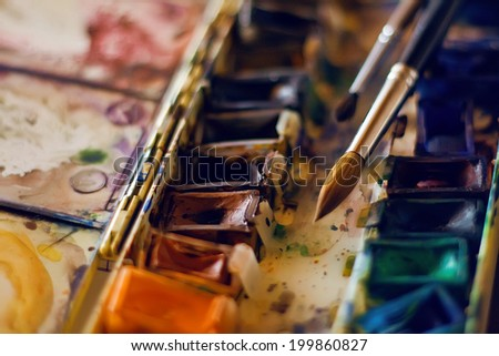 photo of watercolors and brushes - stock photo