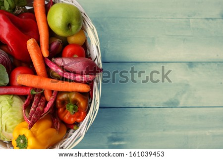 Photo of white basket with vegetables - stock photo