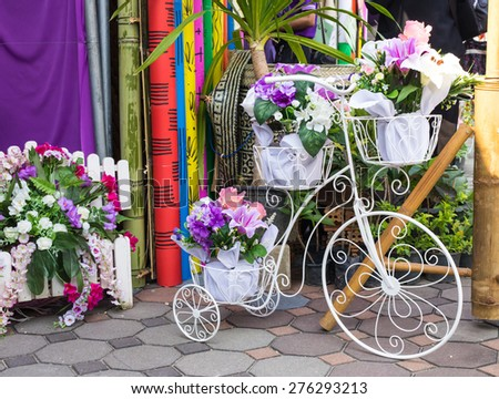 photo of white bicycles with flowers - stock photo