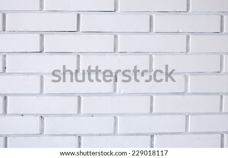 Photo of white brick wall suitable for background - stock photo