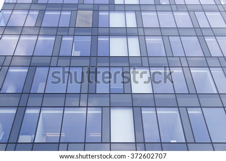 Photo of windows in modern office building.Business building - stock photo