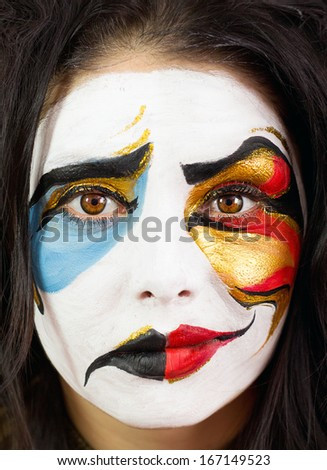 Photo of woman in a mask of two moods - stock photo