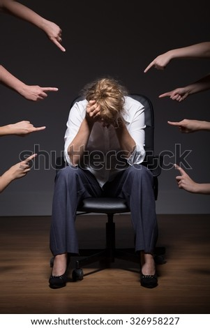 Photo of woman overwhelmed and overloaded at work - stock photo