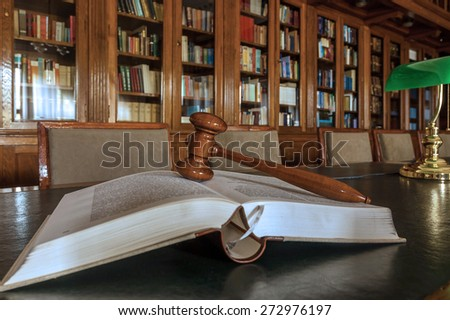 Photo of wooden judge's gavel in the library, focus on the gavel - stock photo