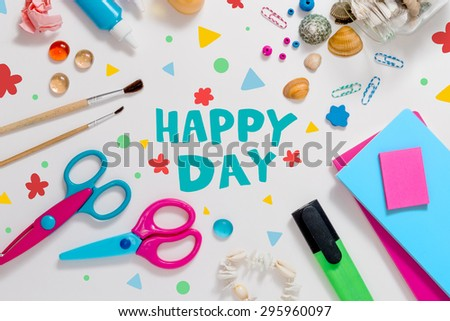 Photo of workplace with lots of stationery objects, shells and lettering happy day. Bright studio shot on light background with dots. - stock photo