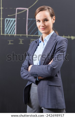 Photo of young beautiful confident businesswoman - stock photo