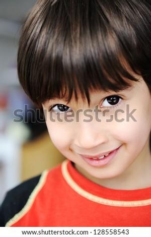 Photo of young boy looking at camera - stock photo