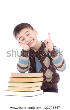 Photo of young boy with books showing finger up isolated over white background - stock photo