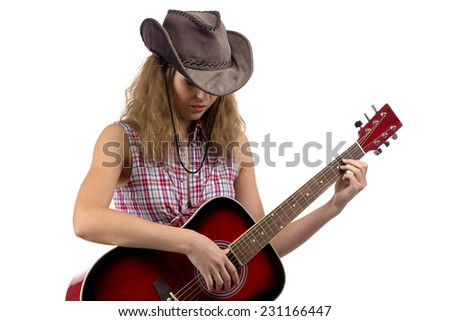 Photo of young cowgirl with the guitar on white background - stock photo