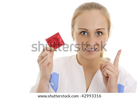 Photo of young doctor with condom. Isolated. - stock photo