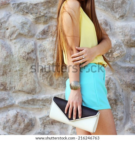 Photo of young fashion beautiful girl casual cloth outfit with clutch spring day - stock photo