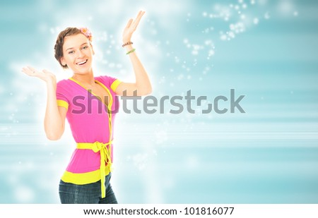 Photo of young joyful sexy woman with hands up on the bright blue background. She is smiling. Lots of Copyspace - stock photo