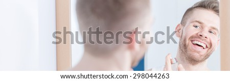 Photo of young pretty man with perfect white smile - stock photo