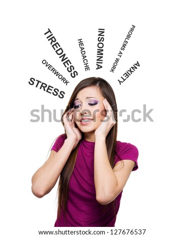 Photo of young woman having stress. Pretty female with hands at temples - stock photo
