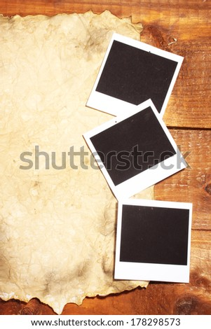 Photo papers with old paper on wooden background - stock photo