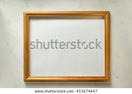 photo picture frame on wall background - stock photo