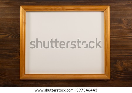 photo picture frame on wooden background - stock photo