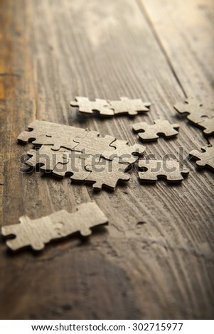 Photo puzzles scattered brown paper on the floor of wooden planks - stock photo