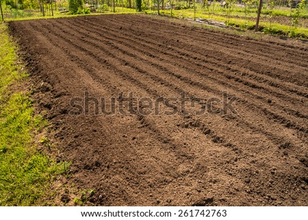 Photo represents recently tilled dirt in preparation for planting the garden. - stock photo