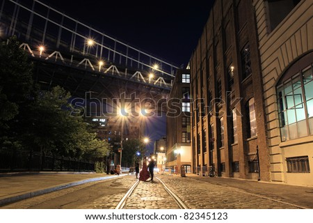 Photo session on a street under the  Manhattan Bridge in Brooklyn NYC at night - stock photo