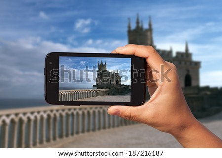 photo shooting on smartphone in tourist journey. Krim. Russia - stock photo