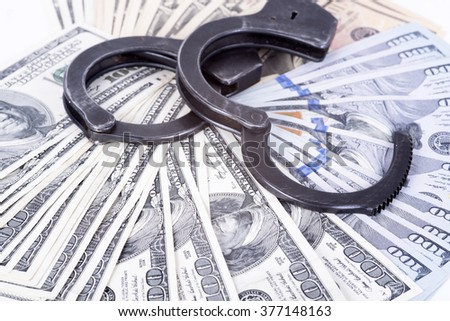 photo showing money with handcuffs - stock photo