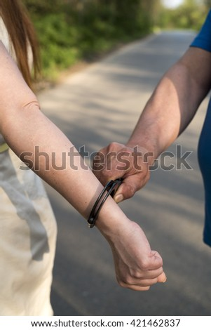 photo showing the arrest of a young woman by a police officer - stock photo