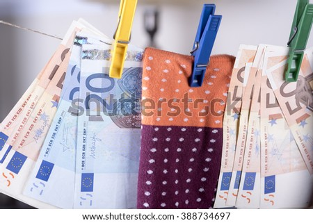photo showing the savings in euros hidden in a sock - stock photo