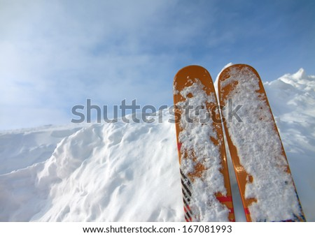 Photo snowy valley with views of the mountains and skiing - stock photo