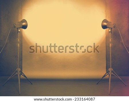 photo studio in old grunge room with concrete wall and paper background, retro filtered, instagram style - stock photo