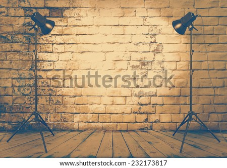 photo studio in old room with brick wall, retro filtered, instagram style - stock photo