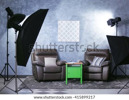 Photo studio interior on grey wall background - stock photo