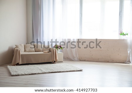 Photo Studio with a sofa and window - stock photo