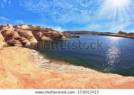 Photo taken fisheye lens. Midday heat. The artificial Lake Powell in the red desert of California.   - stock photo