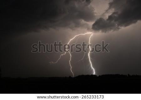 Photo taken in Sweden showing a lightning strike. - stock photo