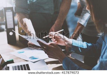 Photo team work process,holding contract hand,signs documents. Account managers young crew works with startup project.New idea presentation, analyze marketing reports. Blurred, film effect, horizontal - stock photo