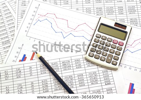 Photo the calculator  with financial the numbers  and graph - stock photo
