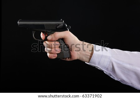 photo the left to bare arms white hand holds firearm isolated on black background - stock photo