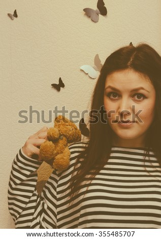 Photo with vintage filter of the young pretty girl and her teddy bear - stock photo
