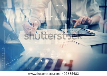 Photo working process. Account manager work new global project in office. Using tablet. Graphics icons, worldwide stock exchanges interface. Horizontal - stock photo