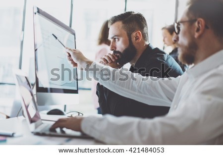 Photo working process.Finance trade manager showing reports screen.Young business crew work with startup project modern office.Desktop computers on table, presentation new idea.Film effect.Horizontal. - stock photo