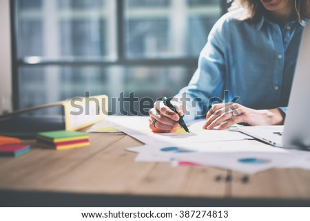 Photo young architect work concept. Woman working with new startup project in modern loft. Generic design notebook on wood table. Horizontal, film effect - stock photo