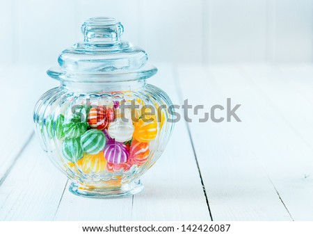 Photograph of a beautiful jar full of assorted colorful candies, perfect for gift purpose. - stock photo