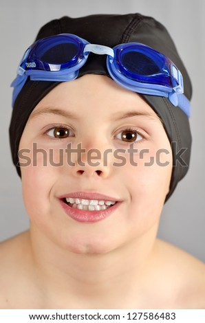 photograph of a child with cap and snorkel in gray - stock photo