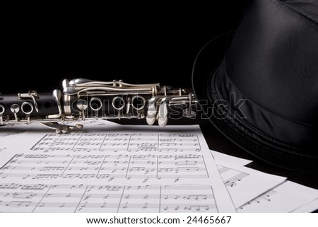 Photograph of a clarinet isolated over sheet music - stock photo