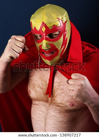 Photograph of a Mexican wrestler or Luchador posing.  - stock photo
